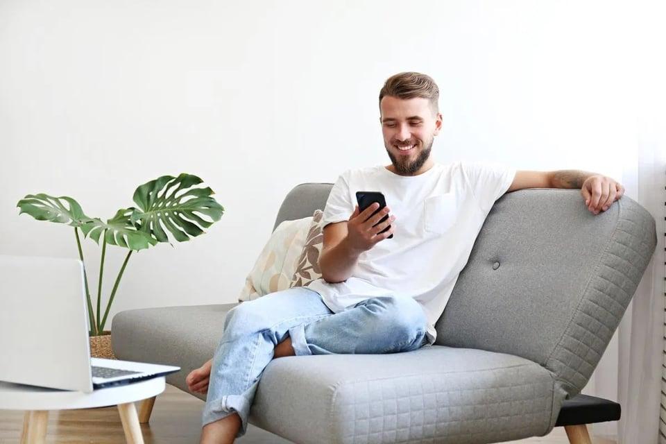 man-using-online-furniture-shopping